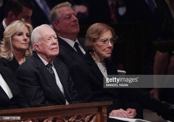 Former US President Jimmy Carter and former US First Lady Rosalynn Carter attend the funeral service for former US president George H W Bush at the...