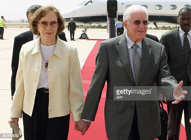 Former US president Jimmy Carter and his wife Rosalynn arrive at Queen Alia international airport in Amman on April 20 2008 Carter arrived in Jordan...