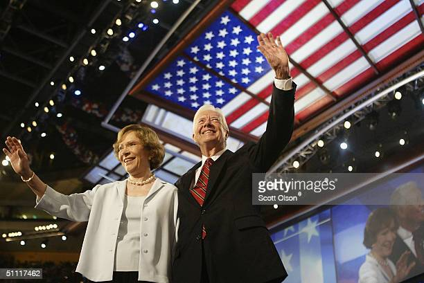 Former US President Jimmy Carter and his wife Rosalynn wave to the audience during the Democratic National Convention at the FleetCenter July 26 2004...