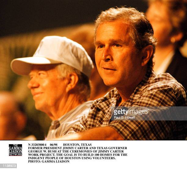 Former US President Jimmy Carter and Texas Governor George W Bush talk during the opening ceremonies of the 1998 Jimmy Carter Work Project a Habitat...
