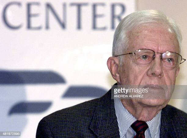 Former US president Jimmy Carter answers a question during a press conference 17 August 2004 in Caracas Venezuelan authorities will conduct a random...