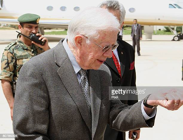 Former US President Jimmy Carter arrives at Queen Alia International airport on April 20 2008 in Amman Jordan Carter in the Middle East tour has met...