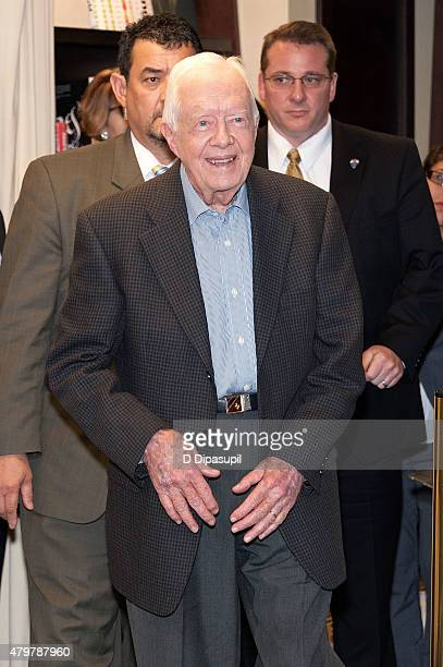 Former US President Jimmy Carter arrives to promote his book Full Life Reflections at Ninety at Barnes Noble 5th Avenue on July 7 2015 in New York...