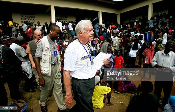 Former US President Jimmy Carter exits a polling site October 11 2005 in Monrovia Liberia The Carter Center founded by Carter to promote peace...