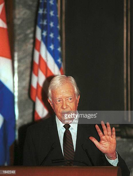 Former US President Jimmy Carter gives an uncensored televised speech May 15 2002 in Havana Cuba Carter urged the oneparty Communist state for a...