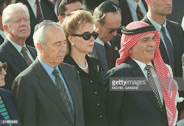 former US President Jimmy Carter Israeli acting Prime Minister Shimon PeresQueen Noor and King Hussein of Jordan attend the funeral of Israeli Prime...