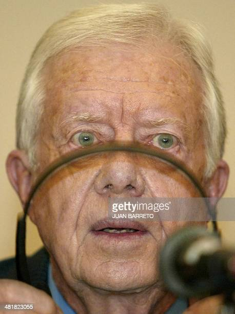 Former US president Jimmy Carter listens to a question during a news conference in Caracas 09 July, 2002. Carter held talks with Venezuelan President...