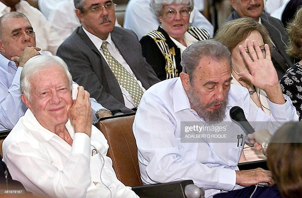 Former US President Jimmy Carter (L) listens to Cuban President Fidel Castro during a 13 May 2002, presentation at the country's top biotech facility, the Center for Genetic Engineering and Biotechnology (CIGB) in Havana. Carter publicly pressed Cuban officials for guarantees that their biotechnology transfers could not be put to improper use after an official US charge that Cuba produced biological weapons.