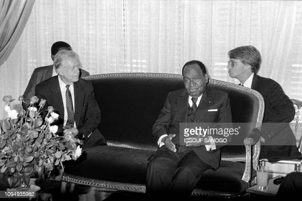 13e48710e9052 Former US President Jimmy Carter meets President of Ivory Coast Félix  HouphouetBoigny on October 26 1991