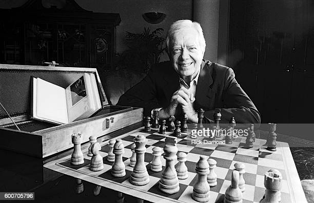 Former US President Jimmy Carter photographed with a wooden Chess set board case and photo album he made by hand at The Carter Center on January...