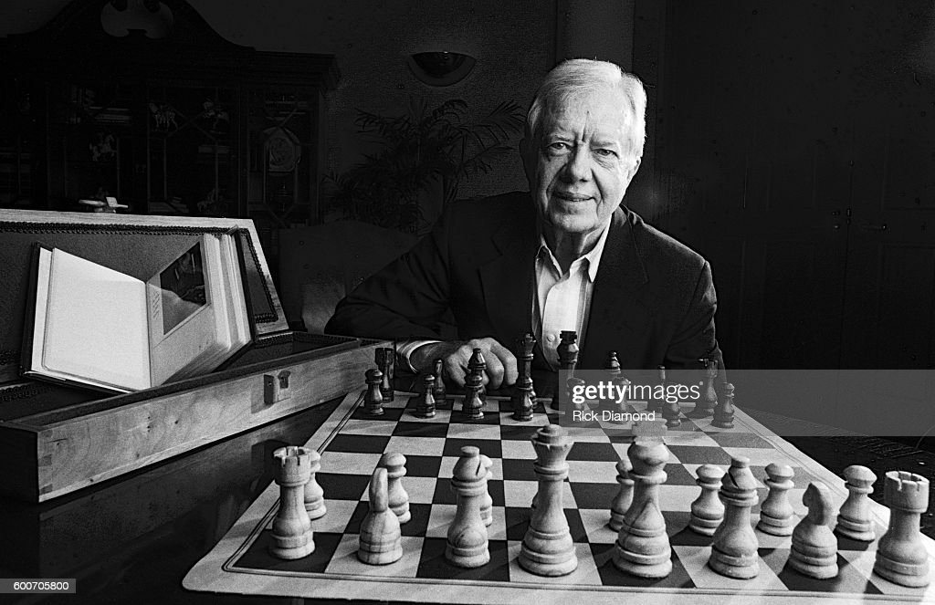 Former US President Jimmy Carter photographed with a wooden Chess set, board, case and photo album he made by hand at The Carter Center on January 4,1993 in Atlanta Georgia.