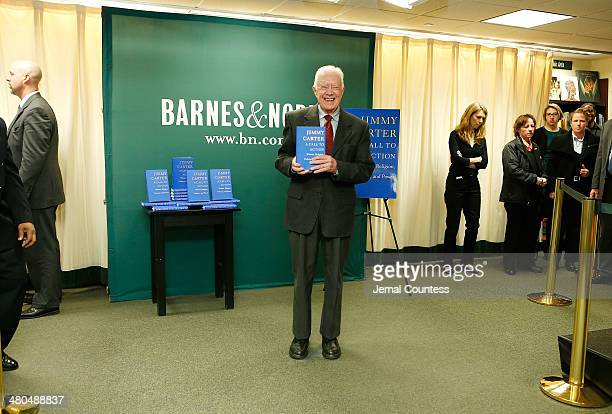Former US President Jimmy Carter poses for a photo as he promotes his new book A Call To Action Women Religion Violence And Power at Barnes Noble 5th...