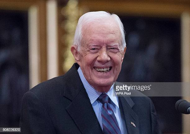 Former US President Jimmy Carter receives delivers a lecture on the eradication of the Guinea worm at the House of Lords on February 3 2016 in London...