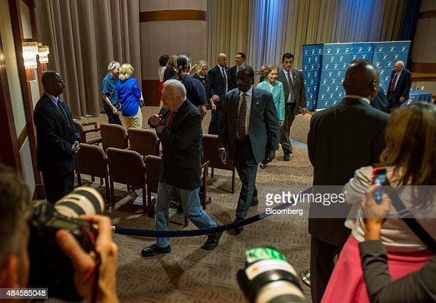 Former US president Jimmy Carter second left departs following a news conference at the Carter Center in Atlanta Georgia US on Thursday Aug 20 2015...