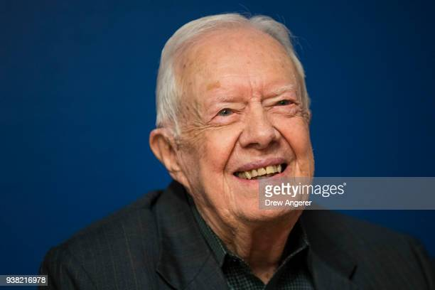 Former US President Jimmy Carter smiles during a book signing event for his new book 'Faith A Journey For All' at Barnes Noble bookstore in Midtown...