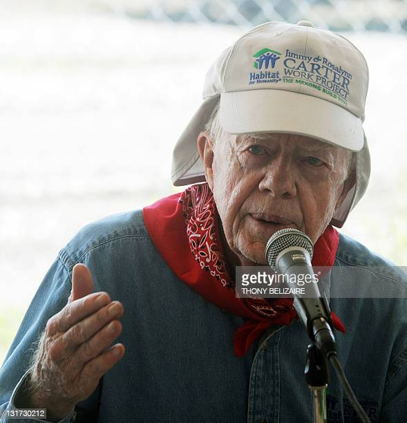 Former US president Jimmy Carter speaks during a press conference about his home building work project on November 7 2011 in Leogane south of...
