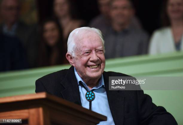 Former US President Jimmy Carter speaks to the congregation at Maranatha Baptist Church before teaching Sunday school in his hometown of Plains...