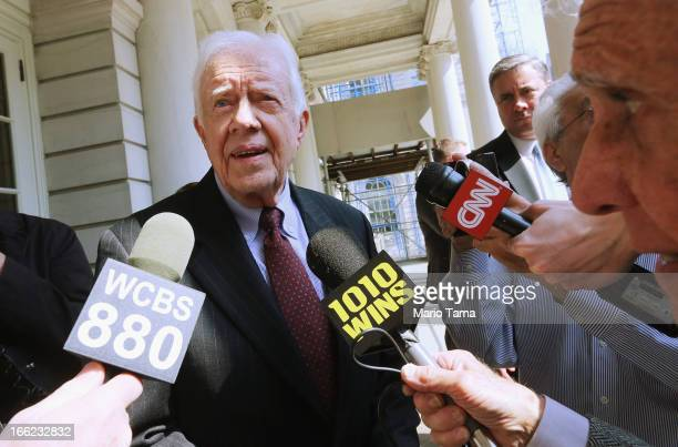 Former US President Jimmy Carter speaks to the media at City Hall after meeting with New York Mayor Michael Bloomberg on April 10 2013 in New York...