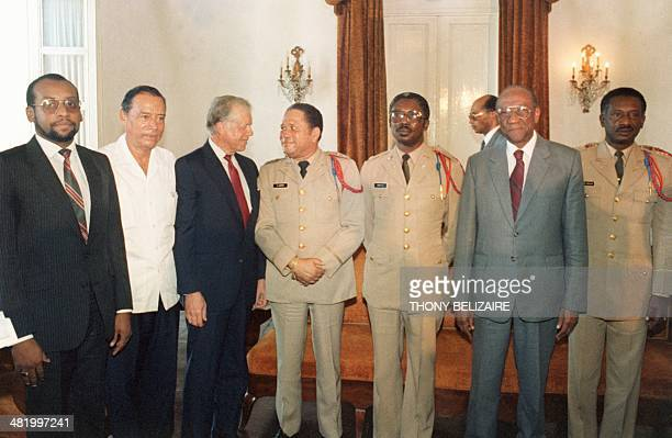 Former US President Jimmy Carter talks to Haitian President Henri Namphy at the National Palace 22 October 1987 in PortauPrince Carter was on oneday...
