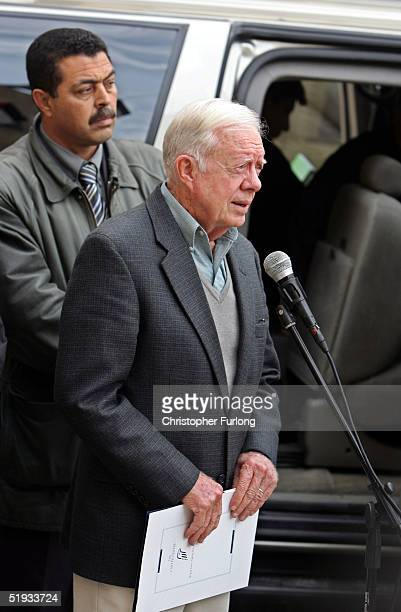 Former US President Jimmy Carter talks to the press after his meeting with Palestinian presidential frontrunner Mahmoud Abbas January 10 2005 in the...