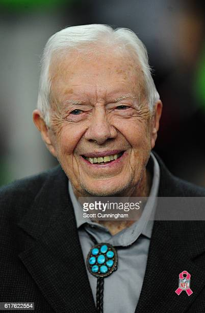 Former US President Jimmy Carter watches warmups before the game between the Atlanta Falcons and the San Diego Chargers at the Georgia Dome on...