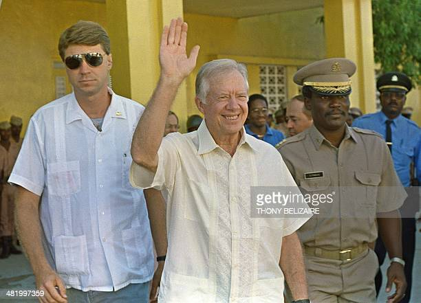 Former US President Jimmy Carter waves after meeting 22 September 1990 in PortauPrince with authorities about the upcoming elections in Haiti