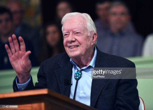 Former US President Jimmy Carter waves to the congregation after teaching Sunday school at Maranatha Baptist Church in his hometown of Plains Georgia...