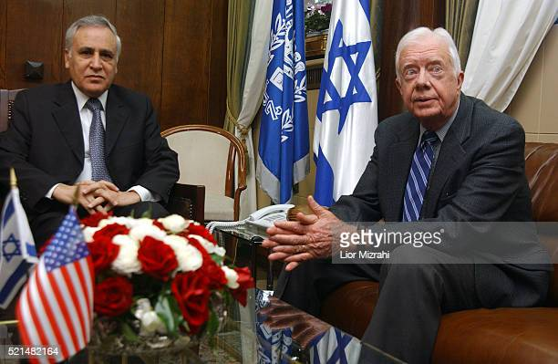 Former US president Jimmy Carter , who arrived to observe the upcoming Palestinian presidential elections, speaks to the press during a meeting with...