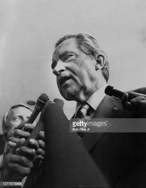 Former U.S. President Richard M. Nixon talks with reporters after leaving Long Beach Memorial Medical Center, July 10, 1976 in Long Beach, California.