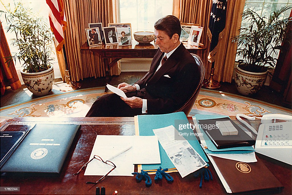 Former U.S. President Ronald Reagan prepares a speech at his desk in the Oval Office for a Joint Session of Congress on April 28, 1981. Reagan turns 92 on February 6, 2003.