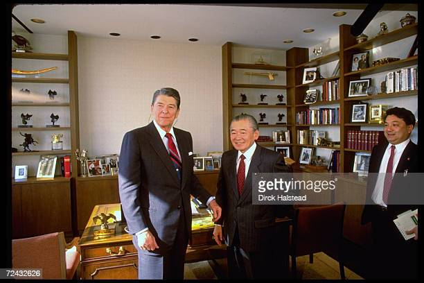 Former US President Ronald Reagan standing in his new Century City office with Japanese PM Noboru Takeshita