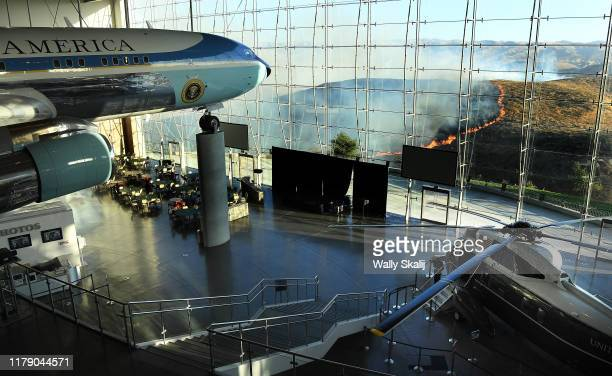 Former US President Ronald Reagan's Air Force One sits on display at the Reagan Presidential Library as the Easy Fire burns in the hills on October...
