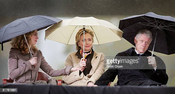 Former US President William J Clinton his wife US Senator Hillary Rodham Clinton and daughter Chelsea listen to speakers at the dedication of the...