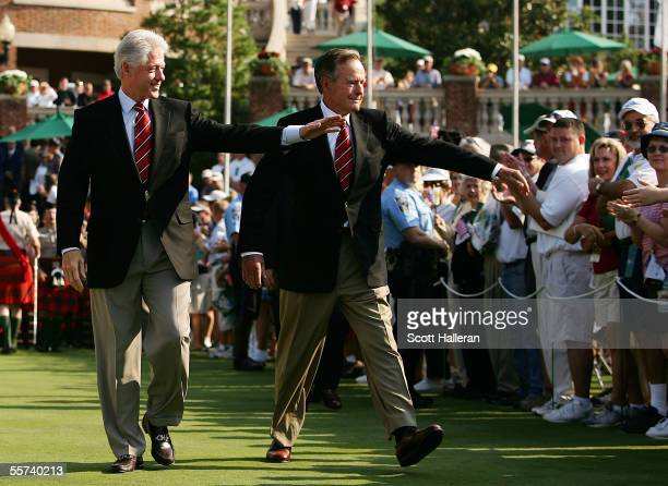 Former US Presidents Bill Clinton and George HW Bush walk to the stage during the Opening Ceremonies of the 2005 Presidents Cup on September 22 2005...