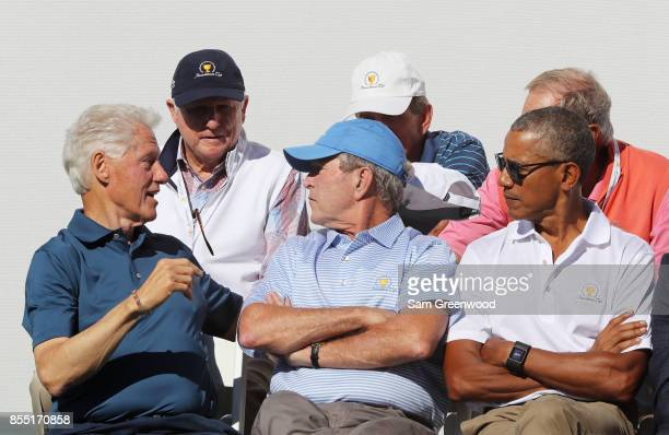 Former US Presidents Bill Clinton George W Bush and Barack Obama attend the trophy presentation prior to Thursday foursome matches of the Presidents...
