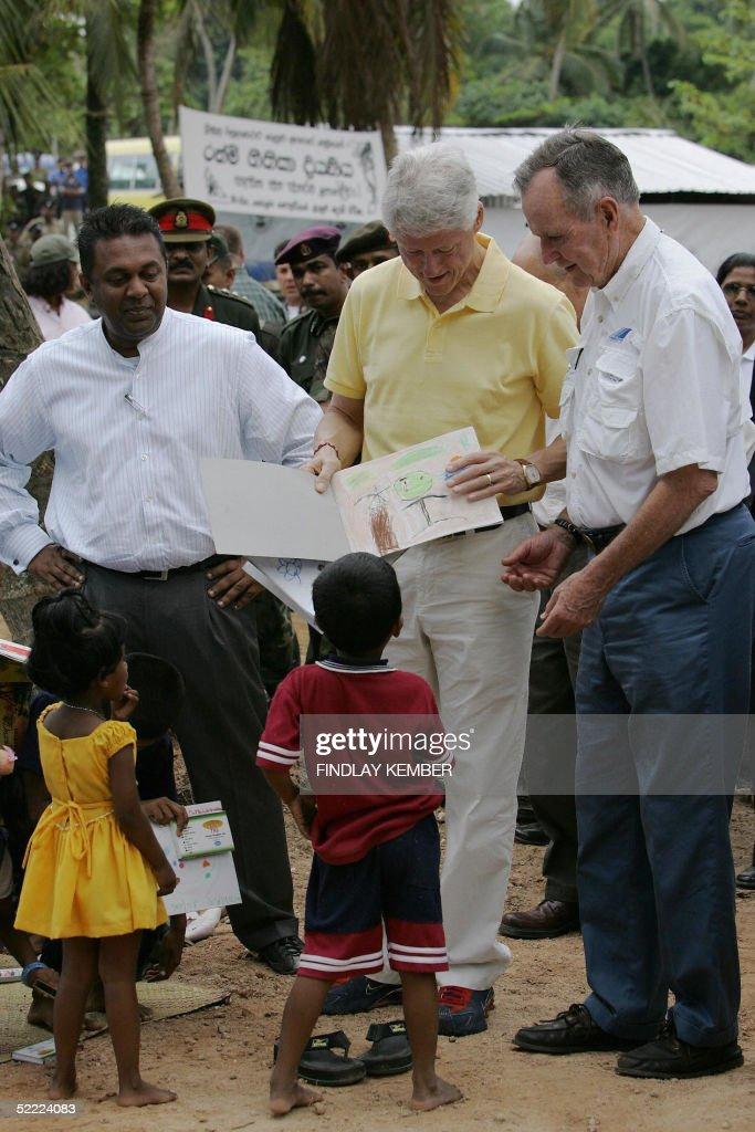 Former Presidents Bill Clinton And George H. Bush Tour Tsunami Devastated R