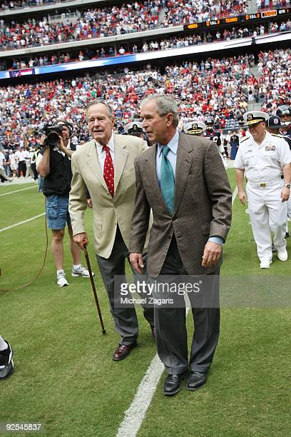 Former US Presidents' George W Bush and George HW Bush walk on the field before the game between the San Francisco 49ers and Houston Texans at...