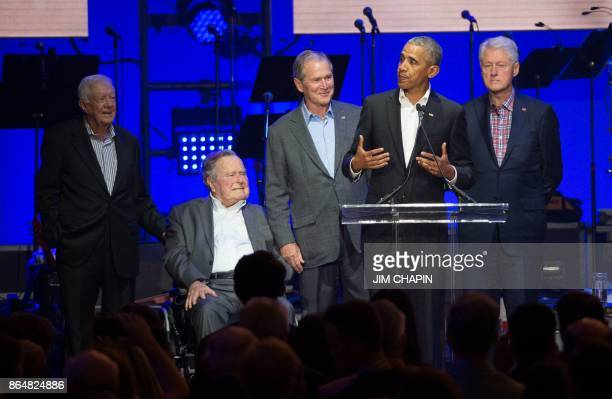 TOPSHOT Former US Presidents Jimmy Carter George H W Bush George W Bush Barack Obama and Bill Clinton attend the Hurricane Relief concert in College...