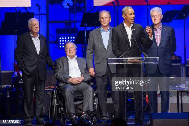 Former US Presidents Jimmy Carter George H W Bush George W Bush Barack Obama and Bill Clinton attend the Hurricane Relief concert in College Station...
