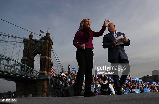Former US Rep Gabby Giffords and her husband Mark Kellygreet supporters during a campaign rally for Democratic presidential nominee former Secretary...
