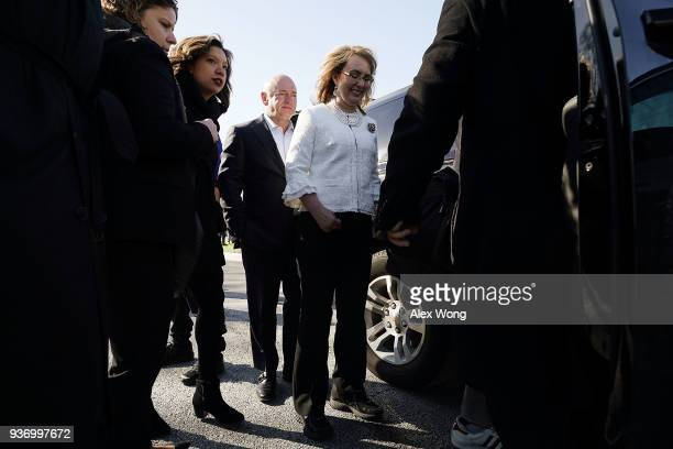 Former US Rep Gabrielle Giffords and her husband retired Navy combat veteran and NASA astronaut Mark Kelly leave after a news conference on gun...