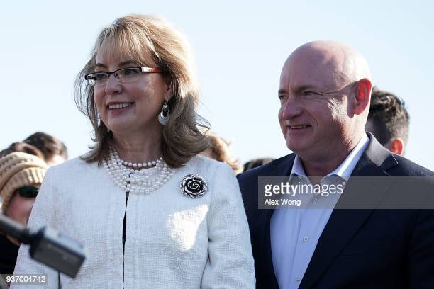 Former US Rep Gabrielle Giffords and her husband retired Navy combat veteran and NASA astronaut Mark Kelly participate in a news conference on gun...