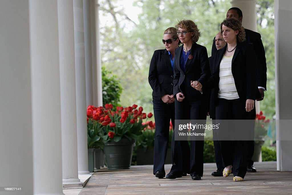 Former U.S. Rep. Gabrielle Giffords (2L) escorts family members of Newtown, CT shooting victims before U.S. President Barack Obama makes a statement on gun violence in the Rose Garden of the White House on April 17, 2013 in Washington, DC. Earlier today the Senate defeated a bi-partisan measure to expand background checks for gun sales.