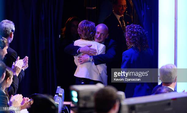 Former U.S. Rep. Gabrielle Giffords hugs her husband former NASA astronaut Mark Kelly stage during the final day of the Democratic National...