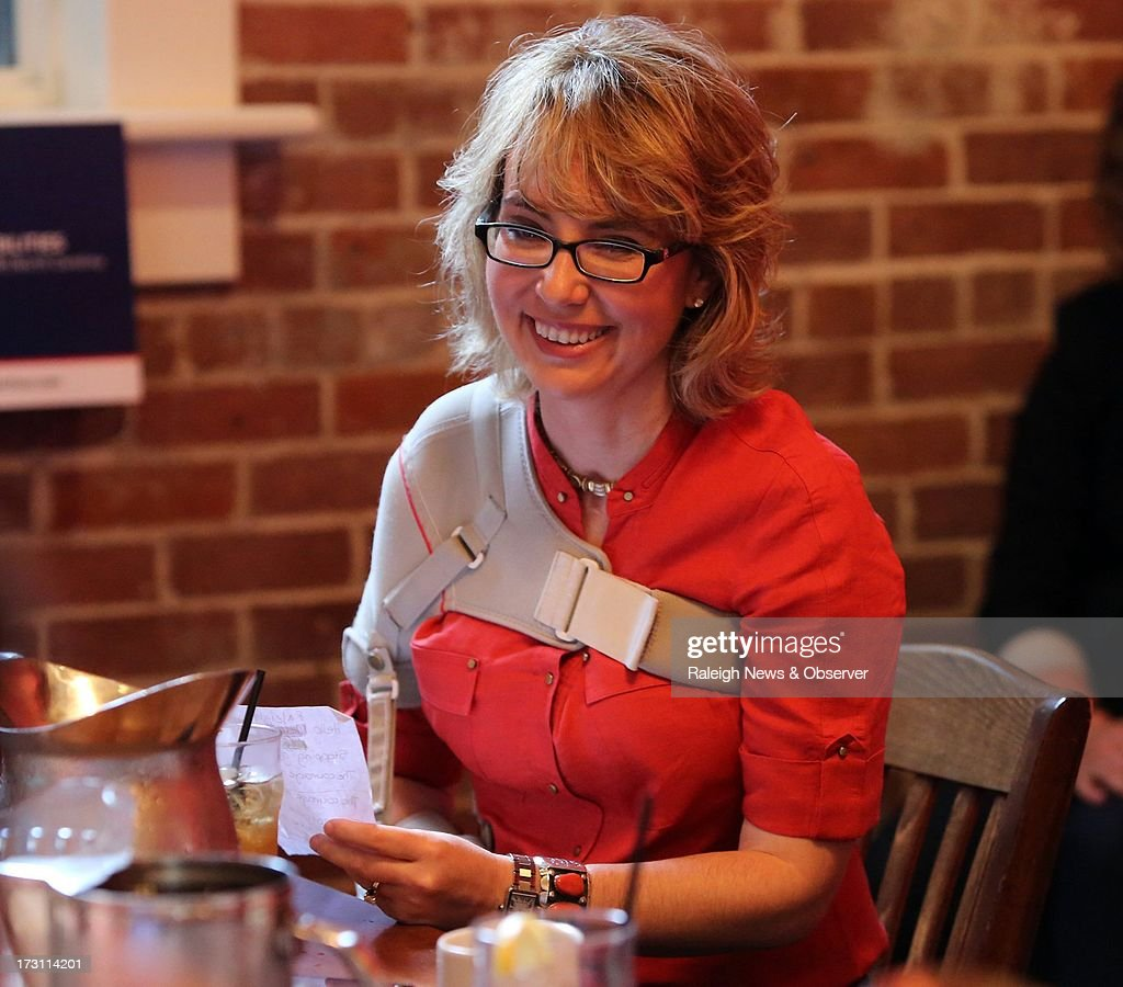 Former U.S. Rep. Gabrielle Giffords speaks to gun owners during a roundtable discussion at The Pit Authentic Barbecue in Raleigh, North Carolina, Sunday, July 7, 2013.