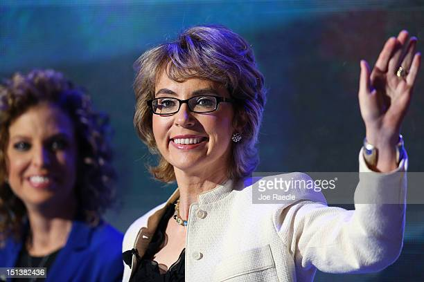 Former U.S. Rep. Gabrielle Giffords walks on stage with Democratic National Committee Chair, U.S. Rep. Debbie Wasserman Schultz during the final day...