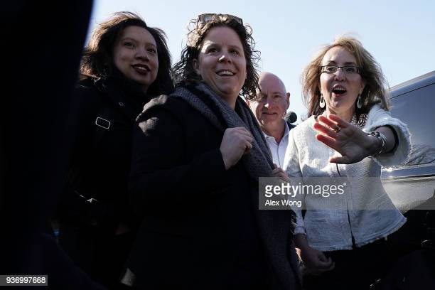Former US Rep Gabrielle Giffords waves to a friend as her husband retired Navy combat veteran and NASA astronaut Mark Kelly and her chief of staff...