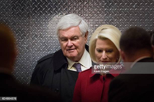 Former US Rep Newt Gingrich and his wife Callista board an elevator as they arrive at Trump Tower on November 21 2016 in New York CityPresidentelect...