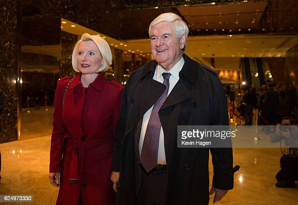 Former US Rep Newt Gingrich and his wife Callista leave following his visit with Presidentelect Donald Trump at Trump Tower on November 21 2016 in...