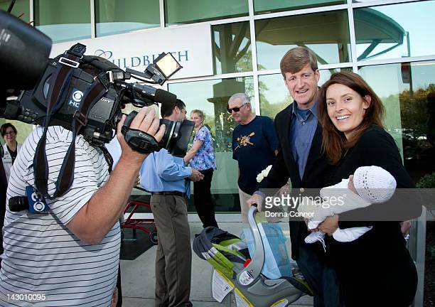 Former US Representative Patrick Kennedy and wife Amy Petitgout show off their new son Owen Patrick born April 15 2012 at the Roger B Hansen Center...
